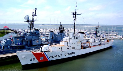 One of the Coast Guard ships (that we toured) and a battleship that were docked near the USS Yorktown.
