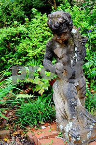 An old statue in a garden of one of Charleston, S.C.'s finest homes.