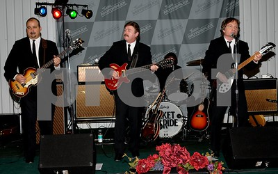 Ticket 2 Ride band - great music, authentic Beatles vintage clothing, instruments and amps.