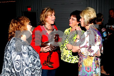 Carolyn Garza, Linda (with her cute chicken gift), Julie Goodson and Linda's sister Tammy Richardson