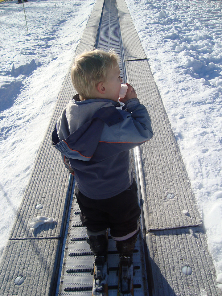 Danny kept himself going by munching on snowballs on the way up the 'magic carpet' every run