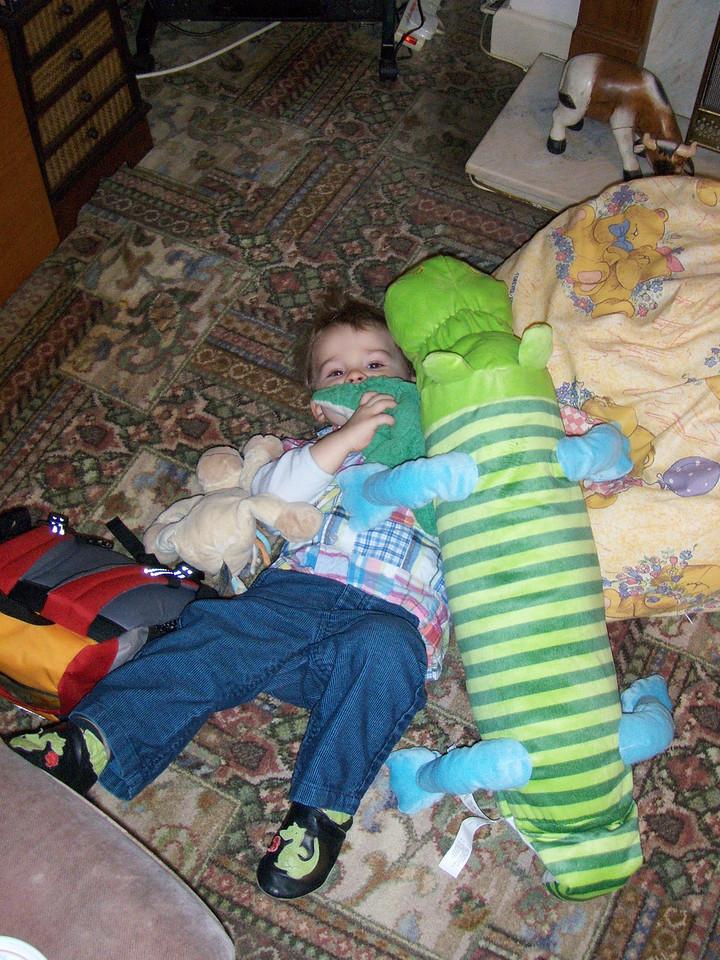 Jack having big cuddles with his new 'crocopotamus'