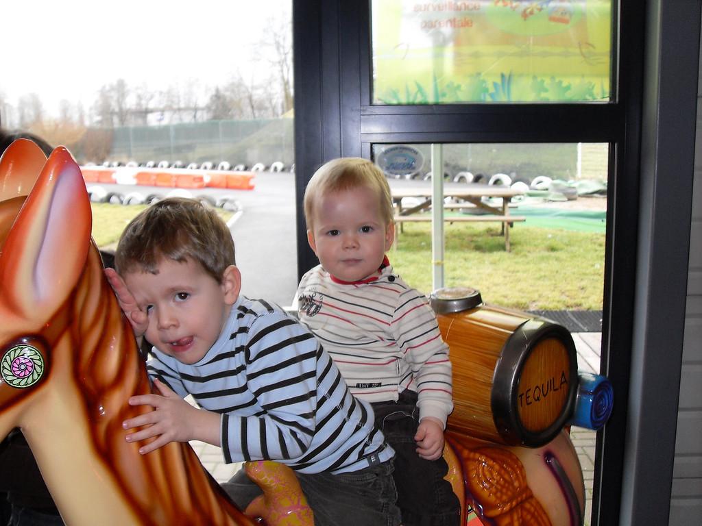 Findlay & Jake on the horsie at Okidok
