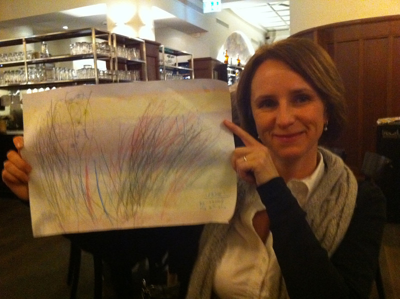 Zuzana is pleased with the picture Danny drew for her over dinner