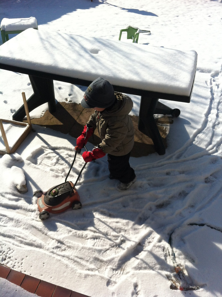 We have lots of snow and it has been really cold: Saturday was beautiful so the boys made the most of the garden. Danny decided to mow the snow