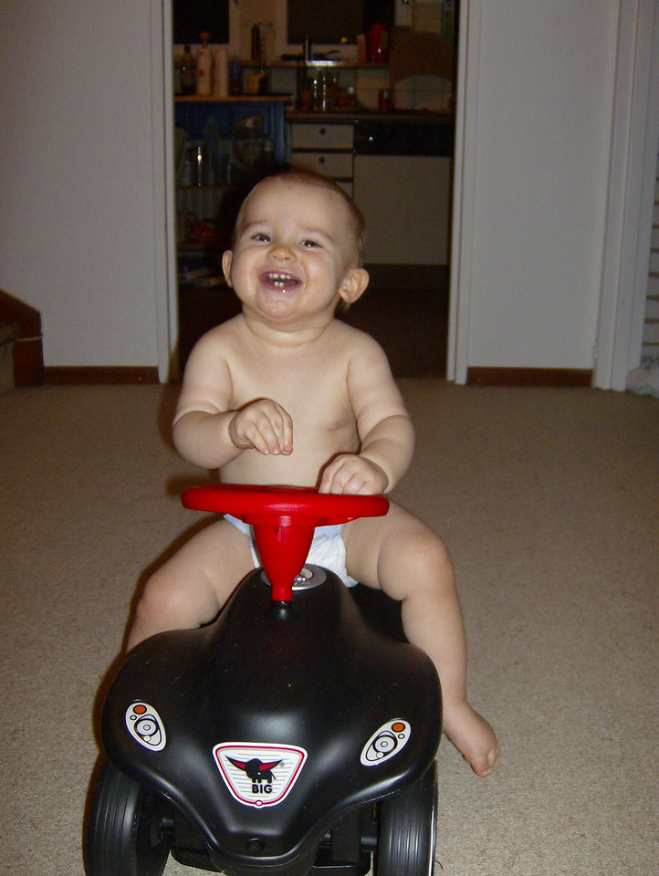 """After everyone left, Jack finally got to go on his """"Bobby Car"""" from the Dilliers. As you can see, he absolutely LOVED it!"""