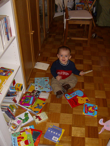Jack has two shelves full of books (largely thanks to Grandma!), he loves playing with them.