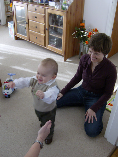 Jack practicing his walking with Charlotte & Rhonda.