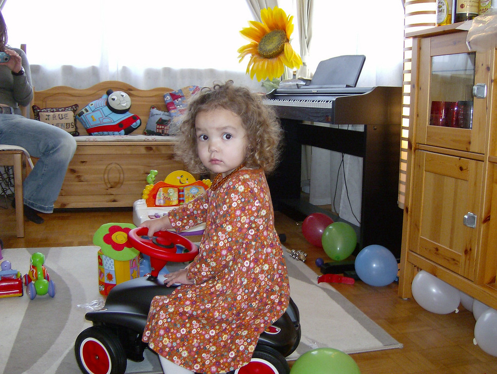 """Kaili trying out the """"Bobby Car"""" that the Dilliers gave Jack for his birthday present."""