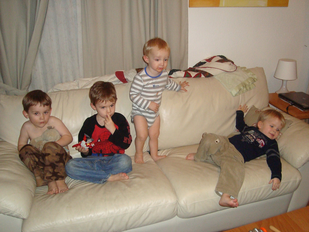 The Halls came over for dinner on New Year's Day. After eating, the boys all chilled & watched Madagascar.