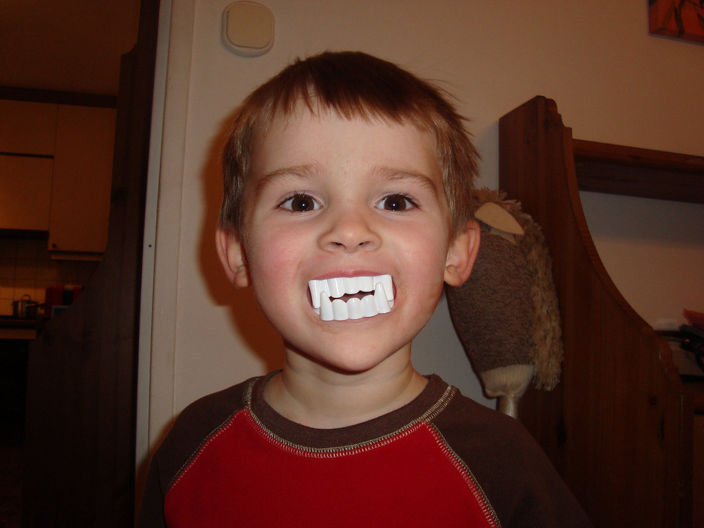 We know funny and funny is little boys with giant fake teeth