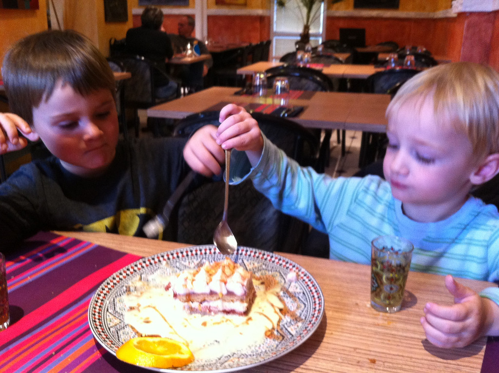 A new Moroccan restaurant opened a couple of hundred yards from our house. Pretty good. Here are the boys sharing a strawberry tiramisu.