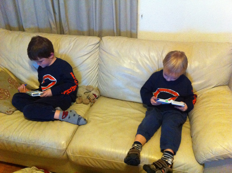 Playing with their new Fisher Price games consoles from the Frickes: quiet Sunday afternoon for us all!