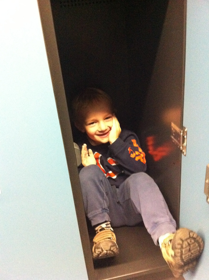 Hiding in the locker after swimming at AquaBasilea