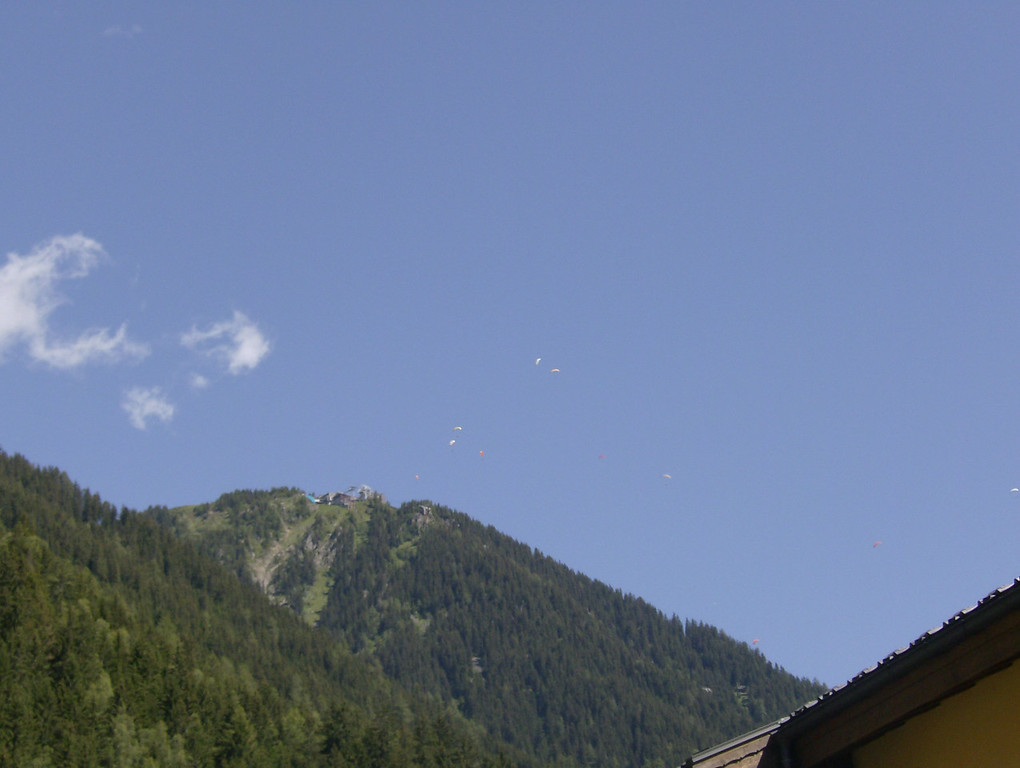 A perfect day for paragliding from the Brevent mid-station apparently. This is the view from the from of our apartment building.