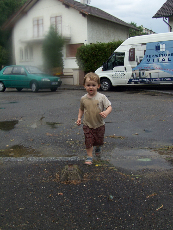 We got caught in a horrendous downpour. When we got home I let Jack splash about in the puddles ending with the predictable face-plant.