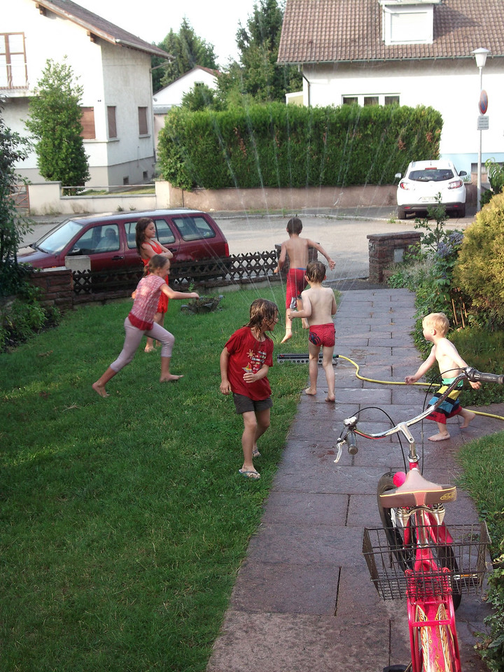 The neighbourhood kids all like to hang in our garden all the time anyway - when we get the sprinkler going, they love it