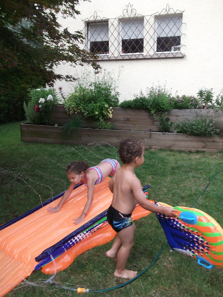 We bought this 'Slip n Slide' and the weather has barely been nice enough to use it - fortunately, little kids are tough about cold weather & cold water. Here's Kaili giving it a go ...