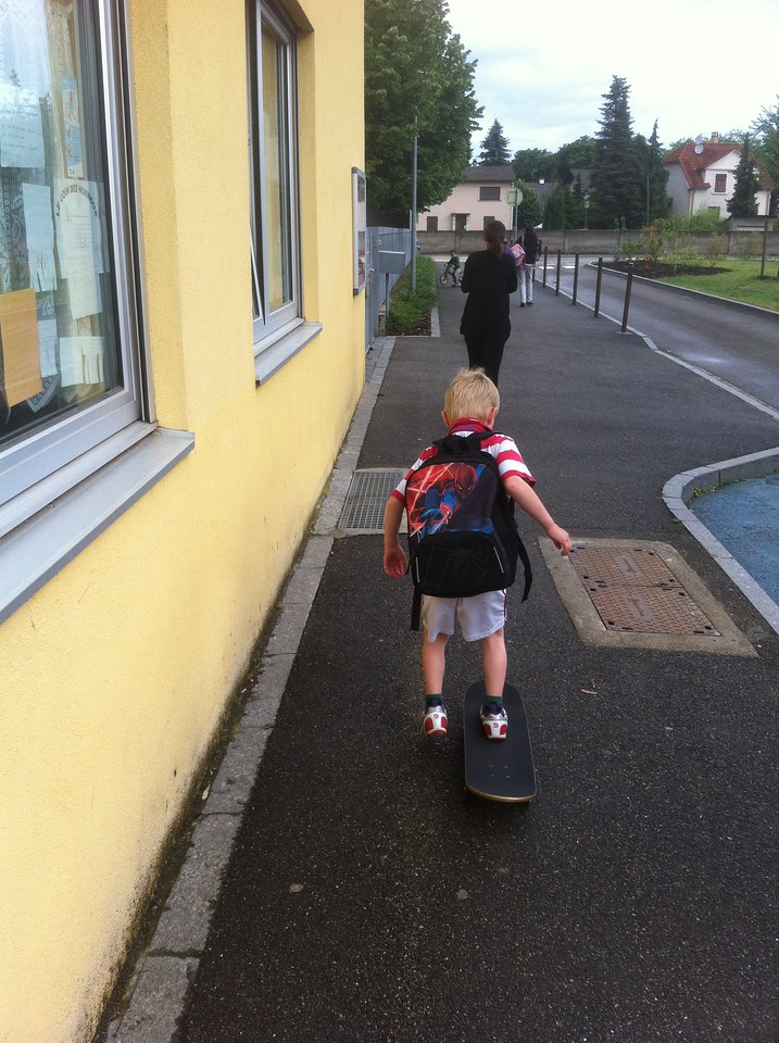 Danny skate-boarding to school