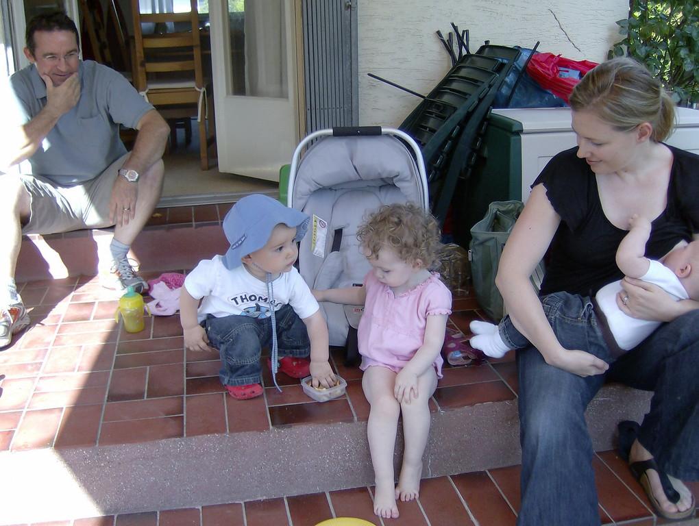Sophia sharing her fischli snacks with Jack.