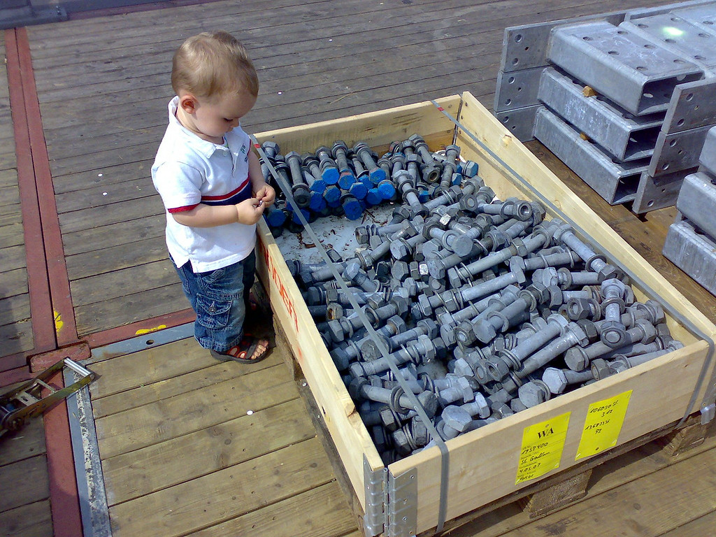 Jack found a giant box of giant nuts & bolts to play with, he was way happy!