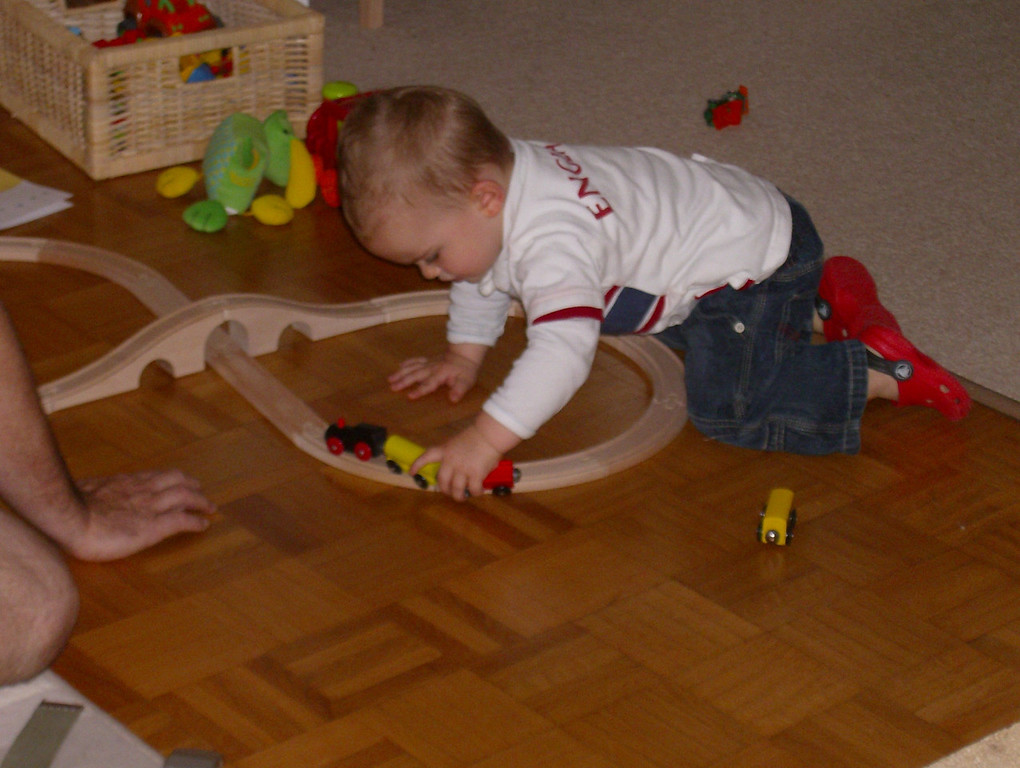 Jack playing with his train set that was a birthday gift from Ciara. He loves it, but gets very frustrated because he knocks the train off the tracks all the time by mistake.