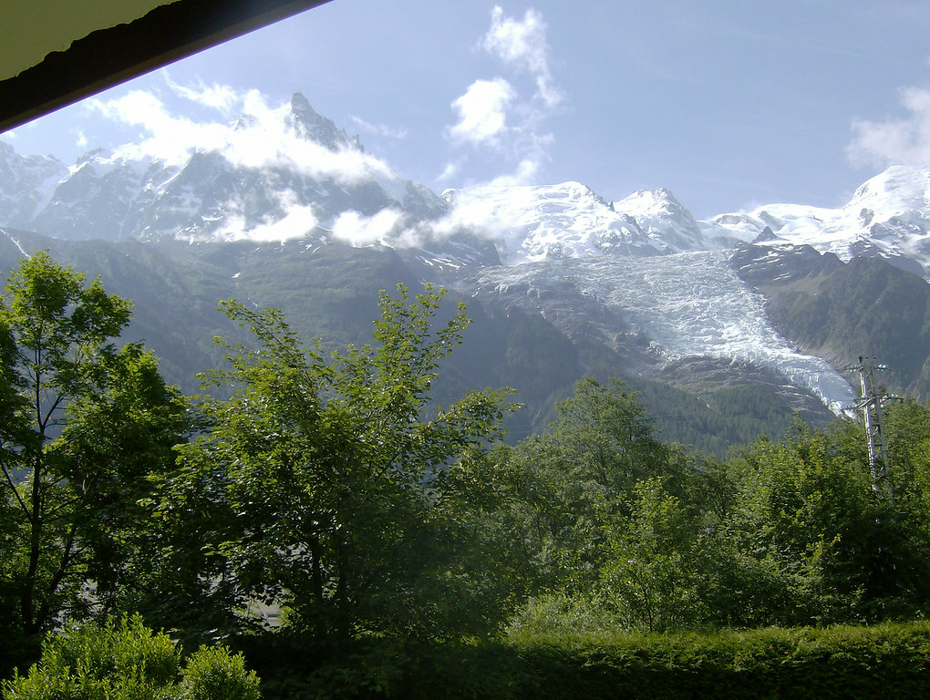 This is the view from the balcony! WQe are surrounded by greenery, this is the view from the Aiguille du Midi to Mont Blanc. It's quiet, all you can hear is the river running & birds chirping (and the occaisional Mont Blanc express as it passes by).