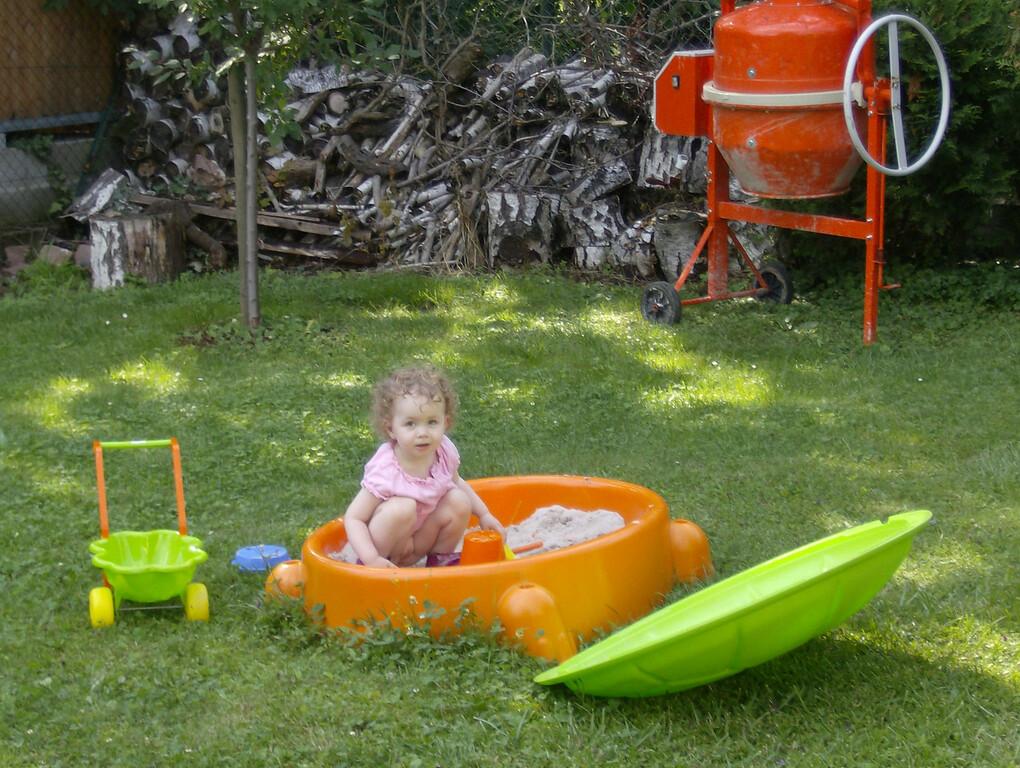 Sophia enjoying herself in the sandpit.