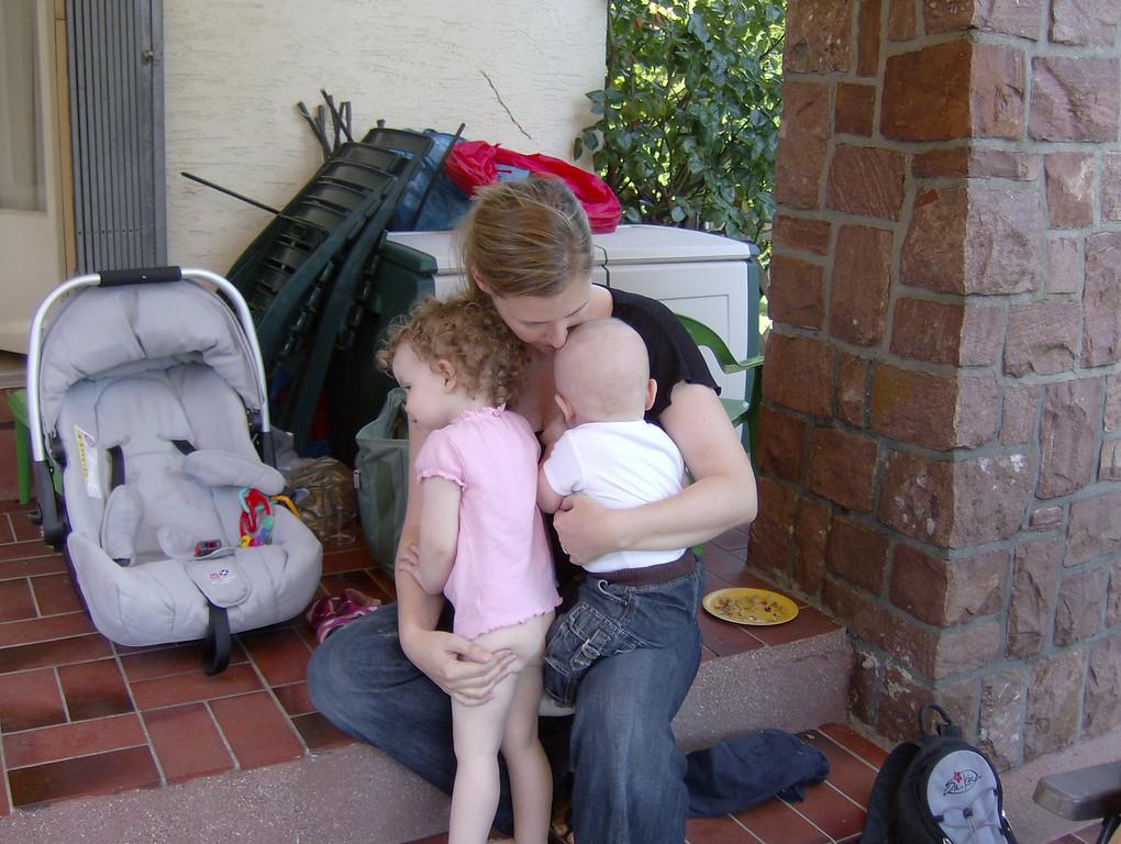 Sophia & Gabriel both getting a cuddle from Em.
