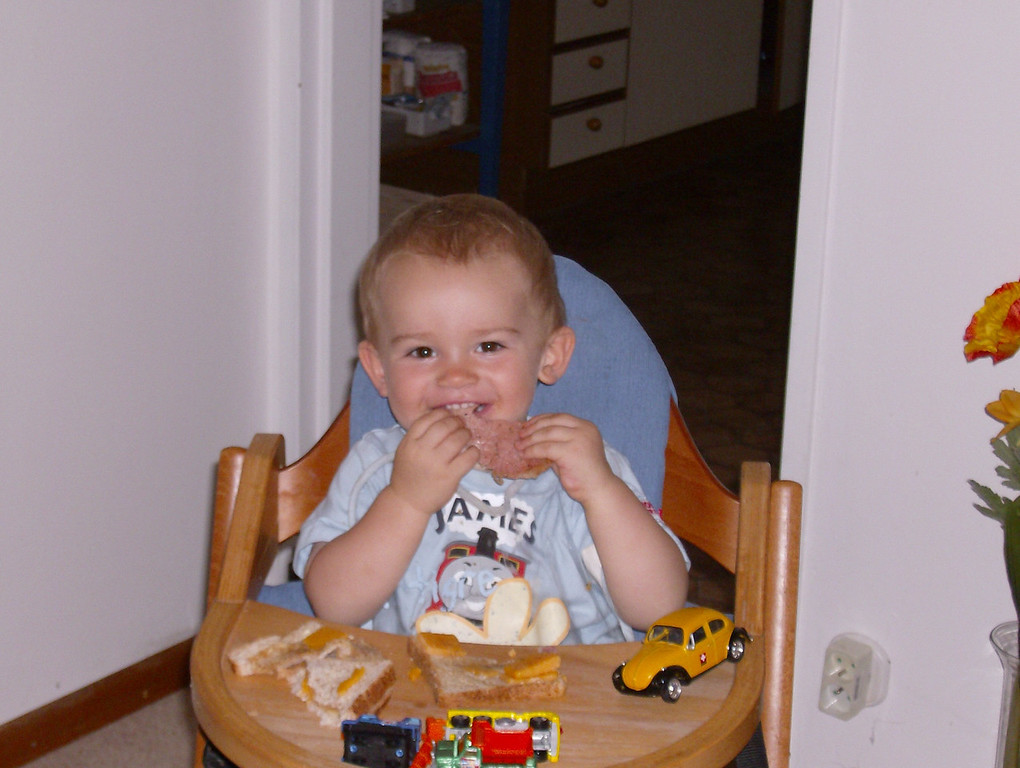 Jack's happy place: a mouthful of bacon & some cars to play with!