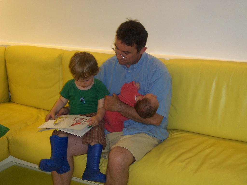 Storytime for the boys. Jack loves wearing these wellies which are 3 sizes too big for him!