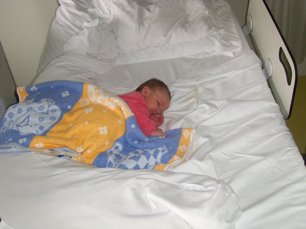 How one tiny person can occupy a whole bed!