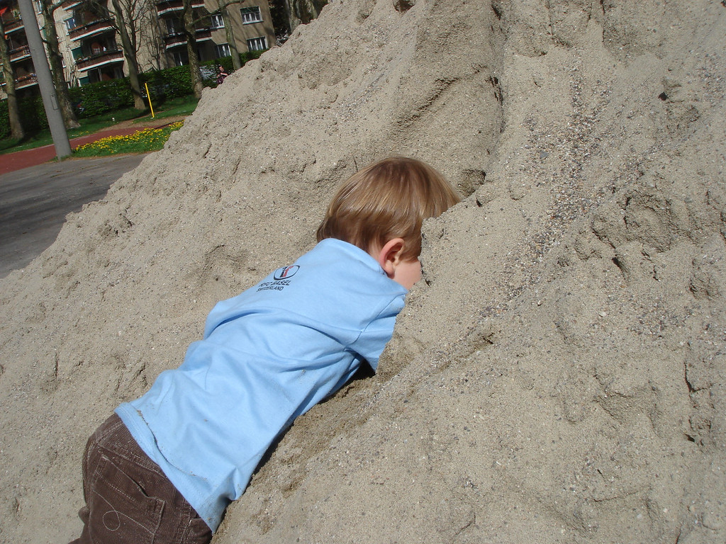 RHonda took this great picture of Jack playing in the sand at the rugby club!