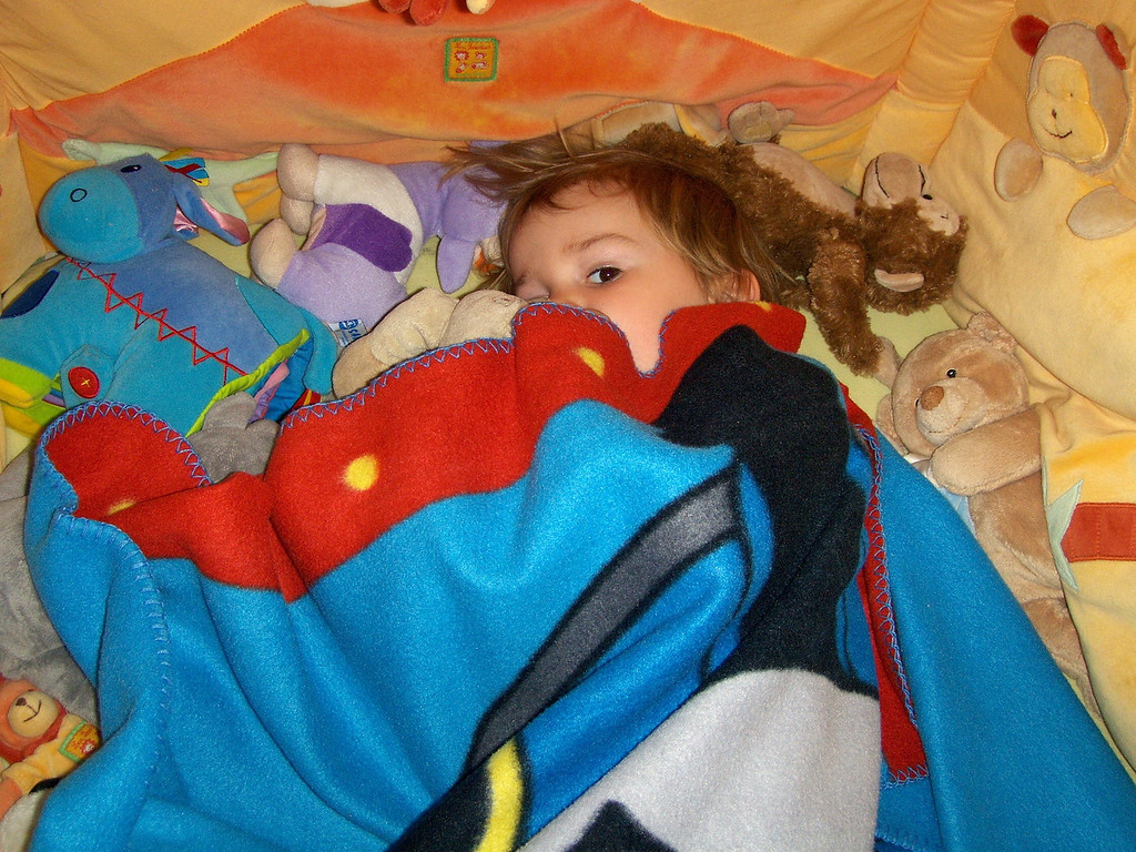Peaking out of the blanket with Horace; his best pal