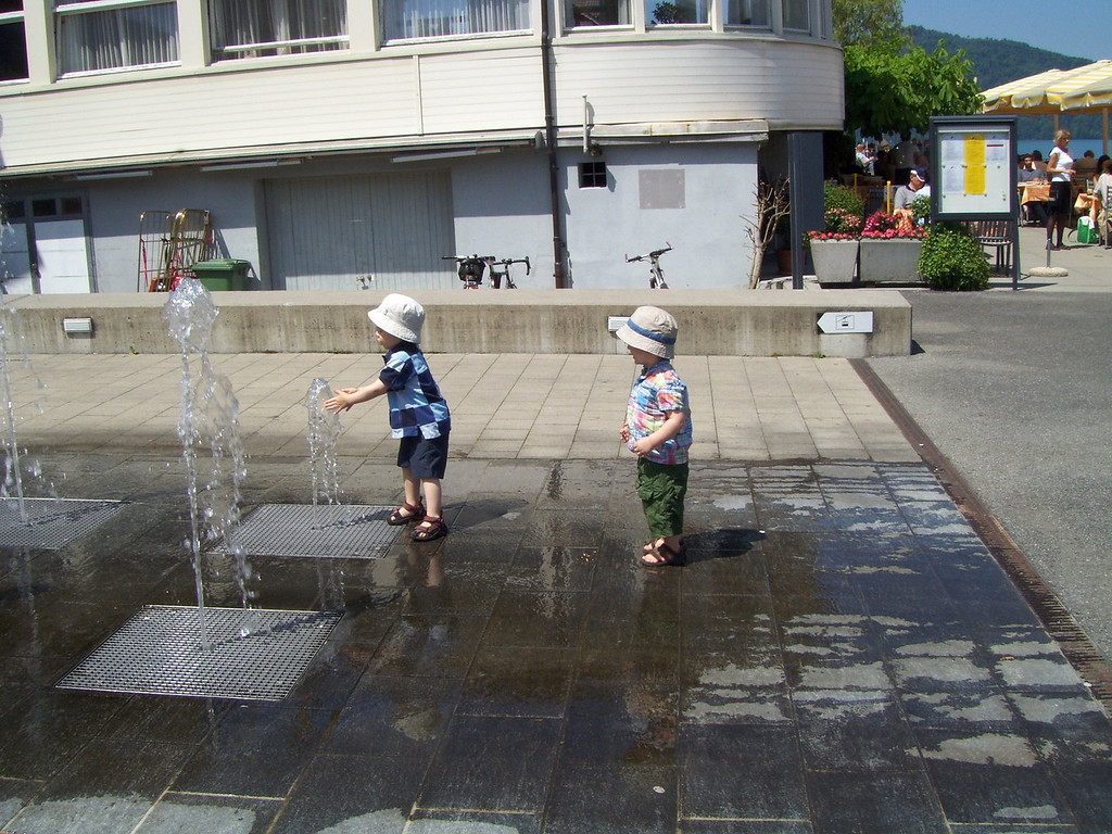 We got off the boat to let the boys run off some energy; they found this fountain ...  ...