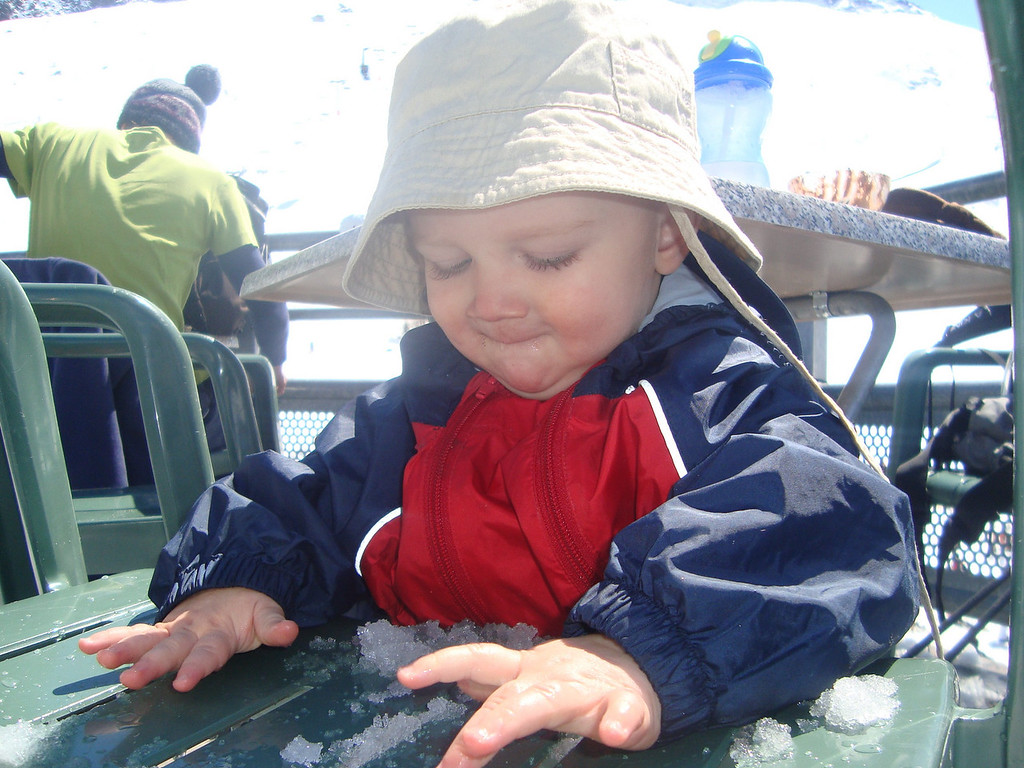 Danny playing with the snow at Grands Montets whilst Jack goes skiing with Daddy