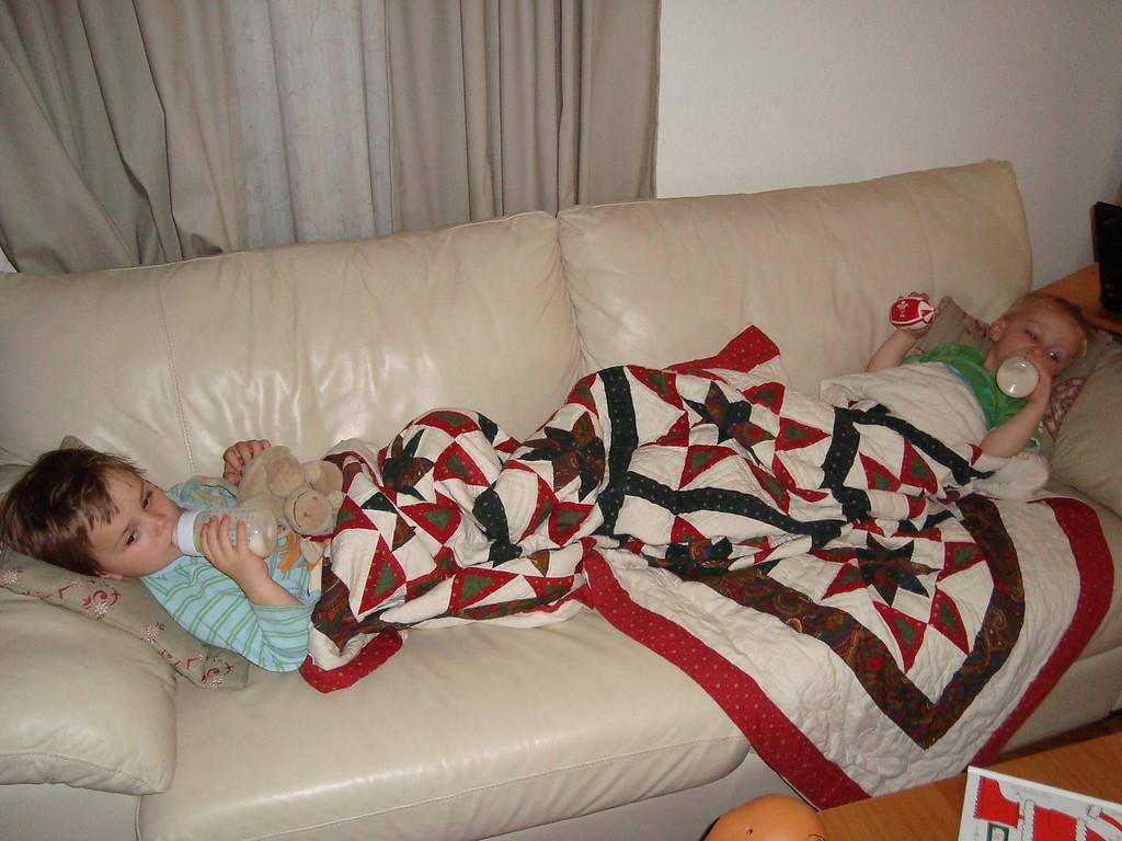 Boys 'having a lax' after a tiring morning at Okidoki