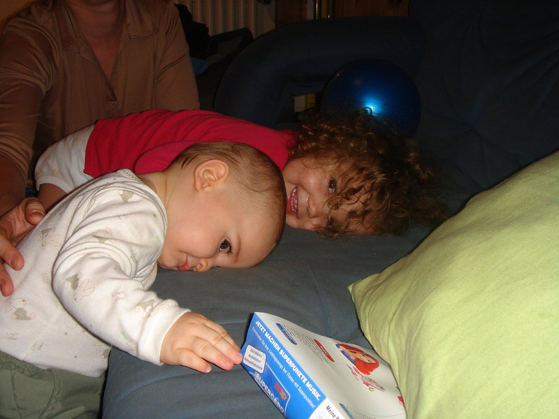 Jack was tired after swimming, he kept laying his head down on the sofa. Kaili wanted to join him for a nap.
