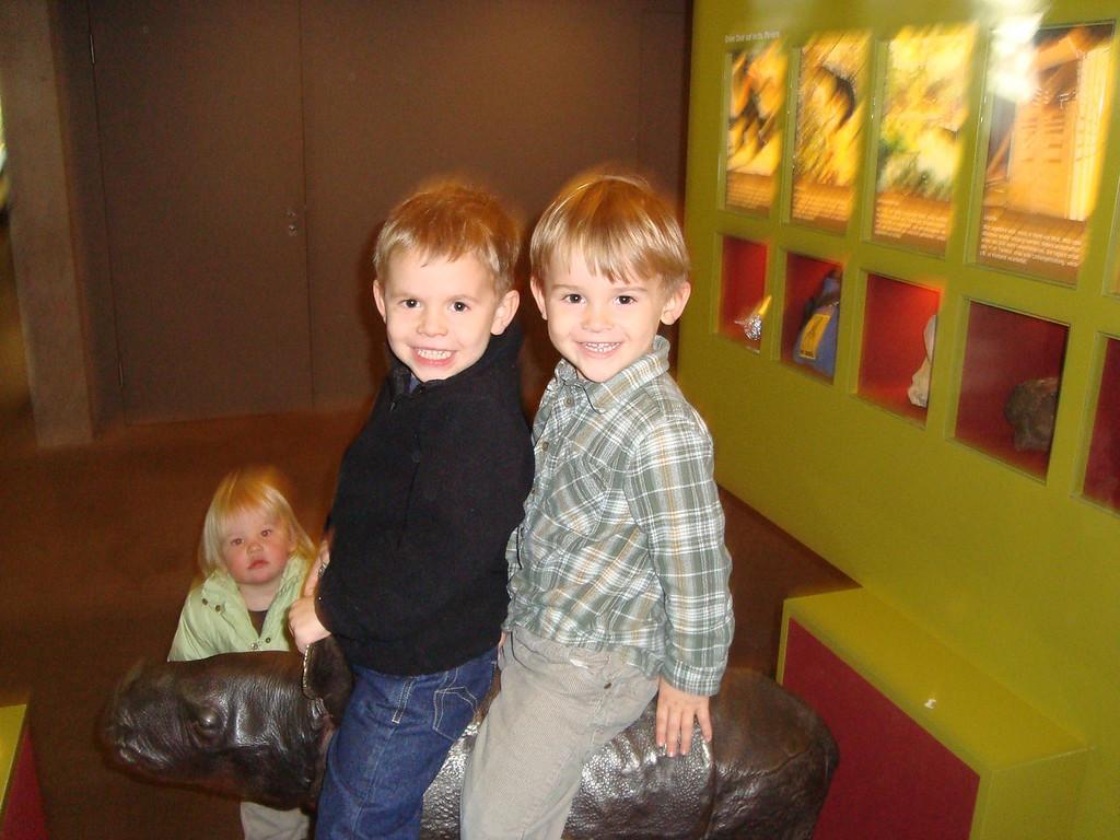 FIndlay & Jack riding the rhino statue