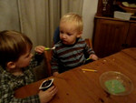 Jack feeding chocolate pudding to Danny