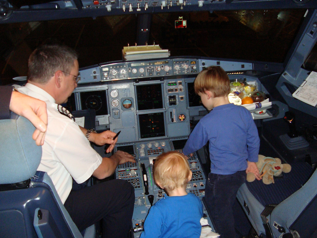 We flew to Heathrow to go visit Jimmy & clan and the nice air crew let the boys into the cockpit on the way out