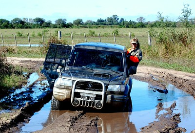 Yep - we're really stuck in the mud on the way to Dove Hunting fields in Argentina.  Loads of rain and many flooded roads in Argentina made for a tricky trip.  Yes indeed - you are seeing this correctly, I'm really crawling out the window to see if there's a way out without getting muddy.