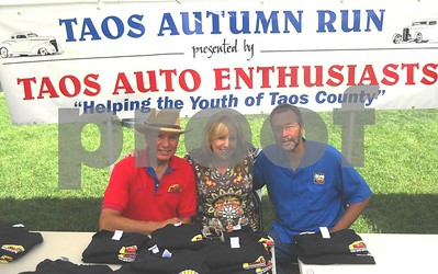 2011 - Bill & I and our friend Marcus at the Taos Car Show.