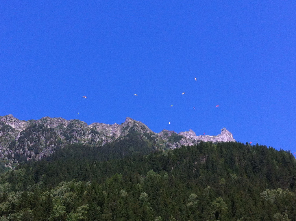 Paragliders off the top of Brevent