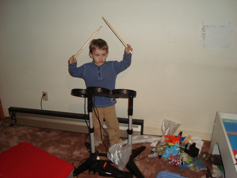 The basement is kiddie-heaven. This is Jack thinking he is playing along to a computer game but in reality just smacking some broken electric drums for a games console