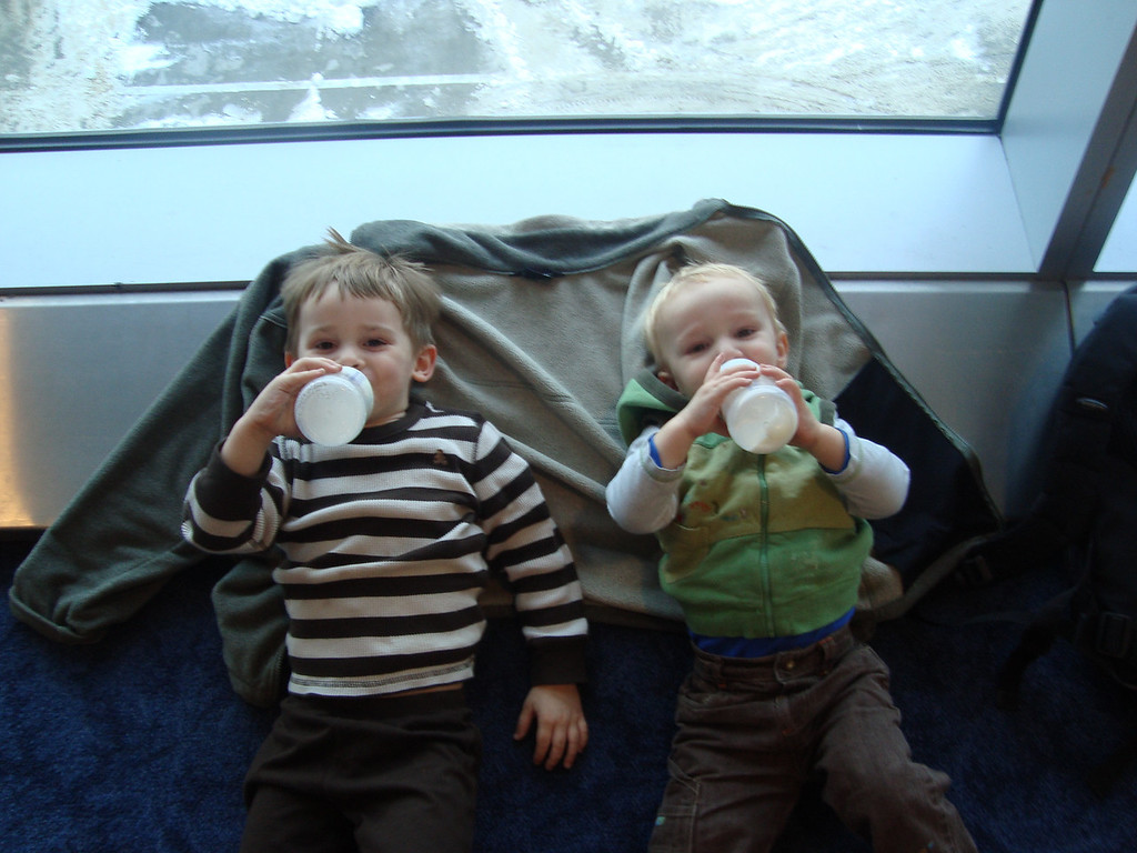 Steeling ourselves for the next leg of the journey with some milk in JFK. 8 1/2 hours is a LONG time on a flight with these two - Jacvk did not sleep at all.