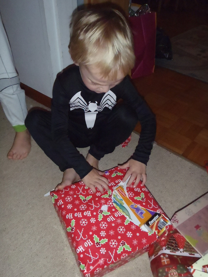 Opening his gift from the Frickes