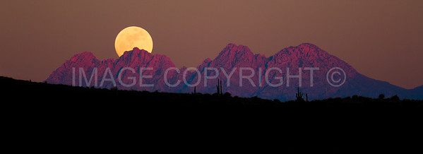 Full moon rising over Four Peaks Mountain