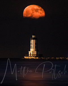 Strawberry moon rising over the lighthouse. -- I tried printing this to no avail.  So it will just live as a digital photo.  Does anyone else have trouble printing?