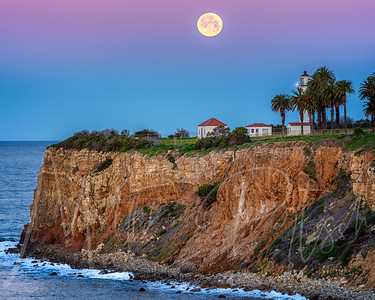 Snow Moon setting at Point Vicente Lighthouse, CA
